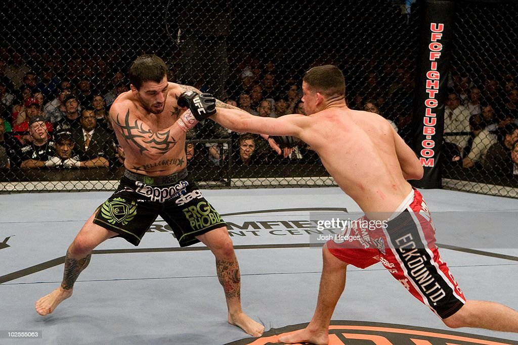 Nate Diaz (red/black shorts) def. Kurt Pellegrino (black shorts) - submission (triangle choke) - 3:06 round 2 during the UFC Fight Night 13 at the Broomfield Event Center on April 2, 2008 in Broomfield, Colorado.