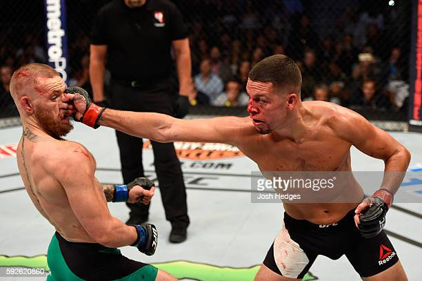Nate Diaz fights Conor McGregor of Ireland in their welterweight bout during the UFC 202 event at T-Mobile Arena on August 20, 2016 in Las Vegas,...