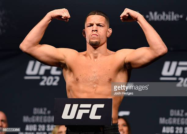 Nate Diaz poses on the scale during the UFC 202 weigh-in at the MGM Grand Hotel & Casino on August 19, 2016 in Las Vegas, Nevada.