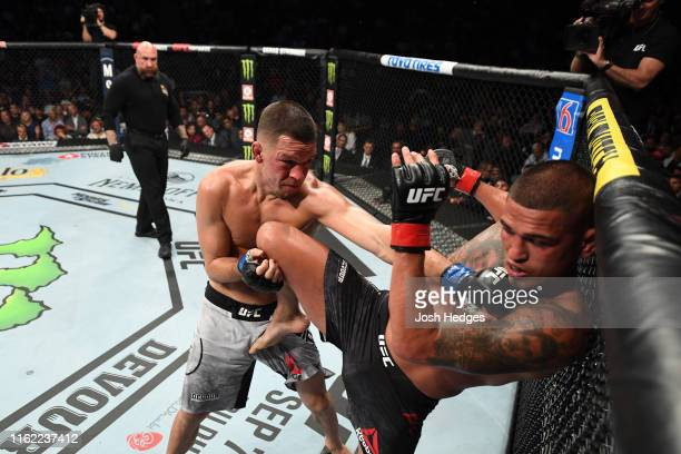 Nate Diaz punches Anthony Pettis in their welterweight bout during the UFC 241 event at the Honda Center on August 17, 2019 in Anaheim, California.