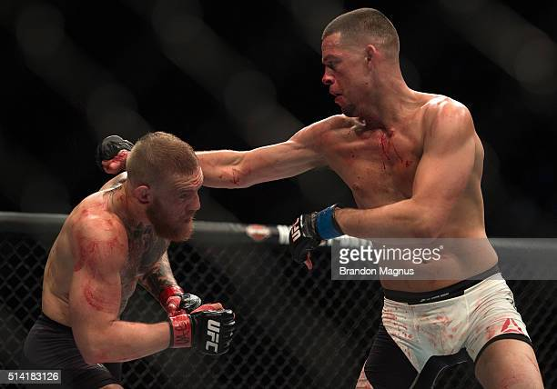 Nate Diaz punches Conor McGregor in their welterweight bout during the UFC 196 in the MGM Grand Garden Arena on March 5 2016 in Las Vegas Nevada