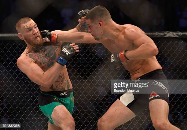 Nate Diaz punches Conor McGregor in their welterweight bout during the UFC 202 event at T-Mobile Arena on August 20, 2016 in Las Vegas, Nevada.
