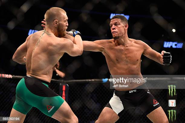 Nate Diaz punches Conor McGregor of Ireland in their welterweight bout during the UFC 202 event at T-Mobile Arena on August 20, 2016 in Las Vegas,...