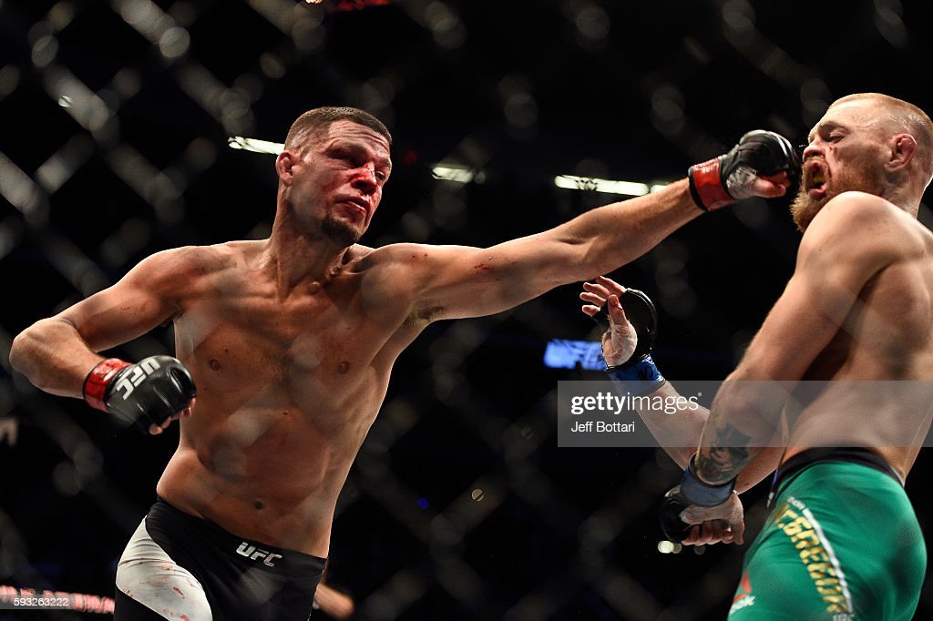 Nate Diaz punches Conor McGregor of Ireland in their welterweight bout during the UFC 202 event at T-Mobile Arena on August 20, 2016 in Las Vegas, Nevada.