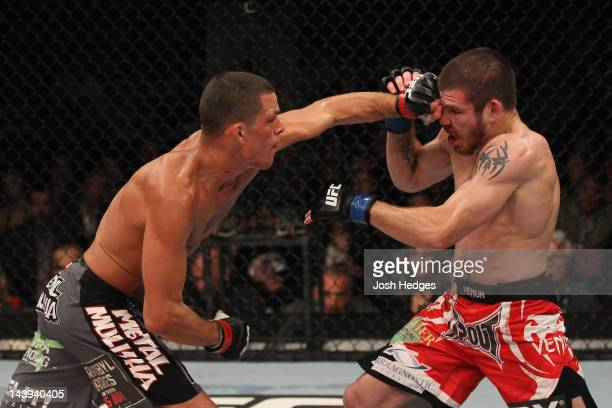 Nate Diaz punches Jim Miller during their Lightweight bout at Izod Center on May 5 2012 in East Rutherford New Jersey