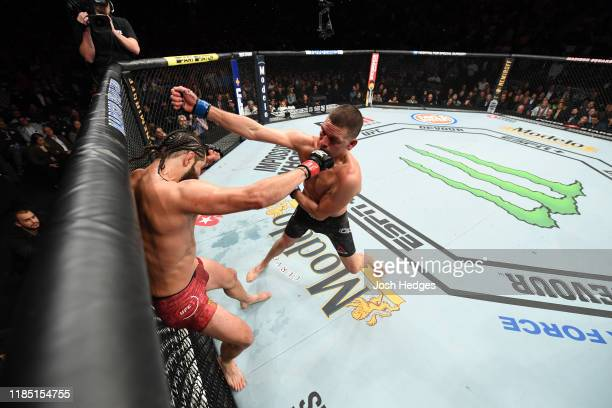 Nate Diaz punches Jorge Masvidal in their welterweight bout for the BMF title during the UFC 244 event at Madison Square Garden on November 02 2019...