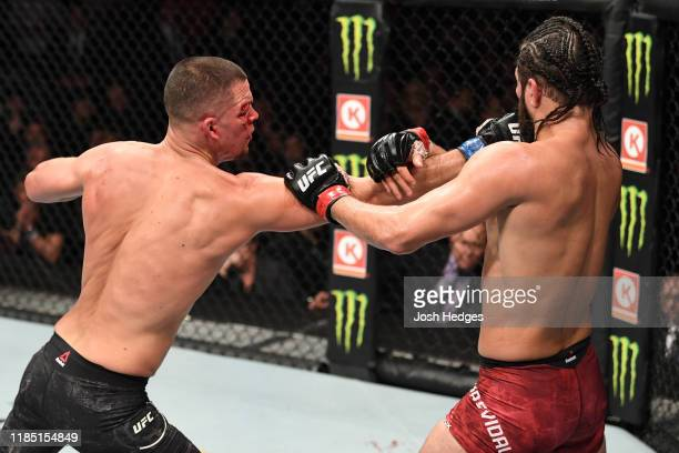 Nate Diaz punches Jorge Masvidal in their welterweight bout for the BMF title during the UFC 244 event at Madison Square Garden on November 02, 2019...