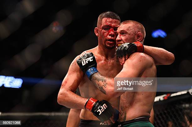 Nate Diaz shakes hands wih Conor McGregor of Ireland at the completion of their welterweight bout during the UFC 202 event at TMobile Arena on August...