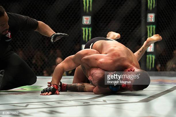 Nate Diaz submits Conor McGregor in their welterweight bout during the UFC 196 in the MGM Grand Garden Arena on March 5, 2016 in Las Vegas, Nevada.
