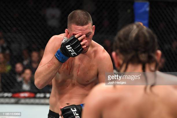 Nate Diaz touches his cut in his welterweight bout for the BMF title against Jorge Masvidal during the UFC 244 event at Madison Square Garden on...