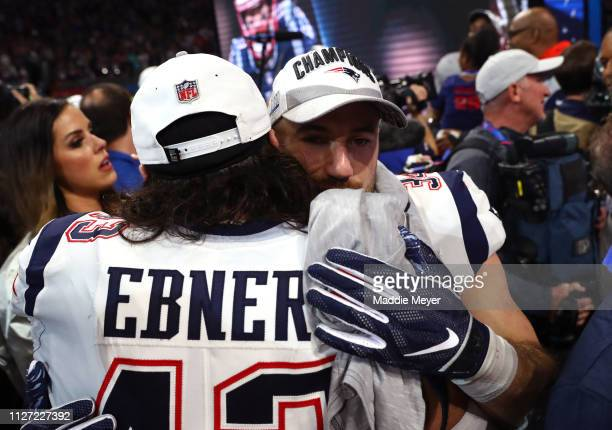 Nate Ebner and Rex Burkhead of the New England Patriots celebrate their 133 win over the Los Angeles Rams during Super Bowl LIII at MercedesBenz...