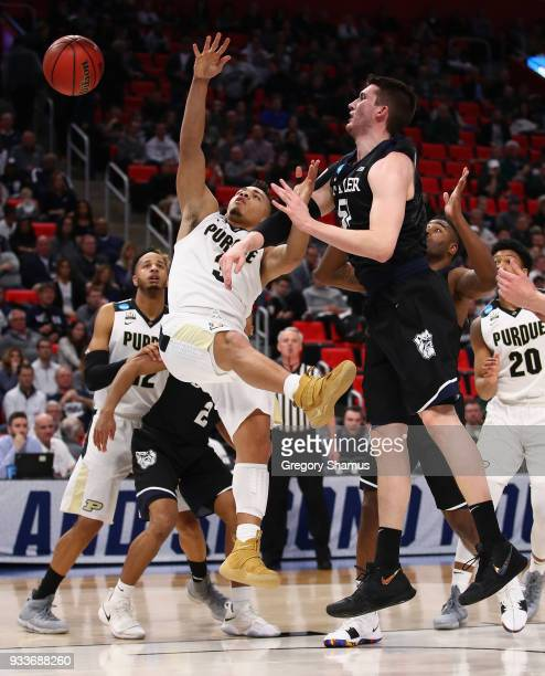 Nate Fowler of the Butler Bulldogs defends a shot by Carsen Edwards of the Purdue Boilermakers during the first half in the second round of the 2018...
