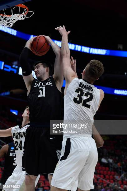 Nate Fowler of the Butler Bulldogs pulls down a rebound from Matt Haarms of the Purdue Boilermakers in the second round of the 2018 NCAA Men's...
