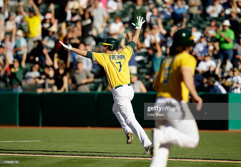 Nate Freiman #7 of the Oakland Athletics celebrates as he runs up the first base line after he hit a single that scored John Jaso #5 in the bottom of the 18th inning to beat the New York Yankees at O.co Coliseum on June 13, 2013 in Oakland, California.