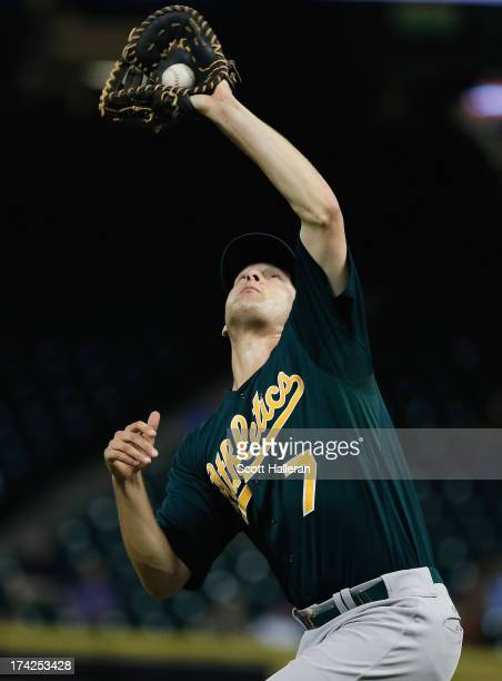 Nate Freiman of the Oakland Athletics makes a catch in the infield for an out in the fourth inning against the Houston Astros at Minute Maid Park on...