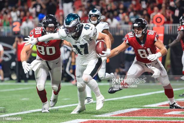 Nate Gerry of the Philadelphia Eagles intercepts a pass thrown by Matt Ryan in front of Luke Stocker and Austin Hooper of the Atlanta Falcons during...