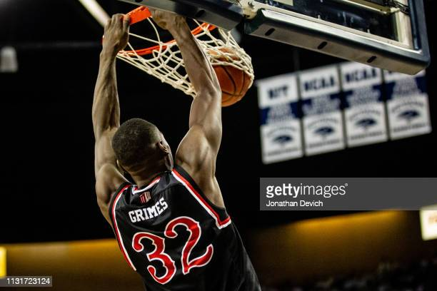Nate Grimes of the Fresno State Bulldogs dunks the ball after getting away from the Nevada Wolf Pack defense at Lawlor Events Center on February 23,...