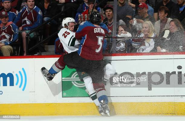 Nate Guenin of the Colorado Avalanche puts a hit on Jonas Brodin of the Minnesota Wild in Game One of the First Round of the 2014 NHL Stanley Cup...