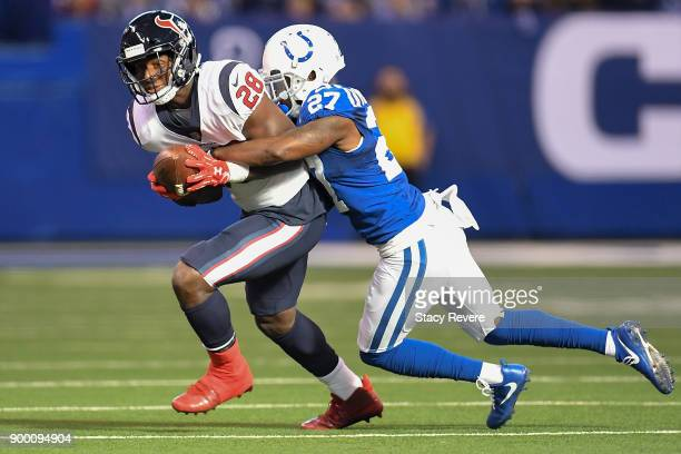 Nate Hairston of the Indianapolis Colts tackles Alfred Blue of the Houston Texans during the first half at Lucas Oil Stadium on December 31 2017 in...