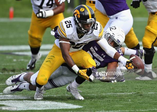 Nate Hall of the Northwestern Wildcats breaks up a pass intended for Akrum Wadley of the Iowa Hawkeyes at Ryan Field on October 21 2017 in Evanston...