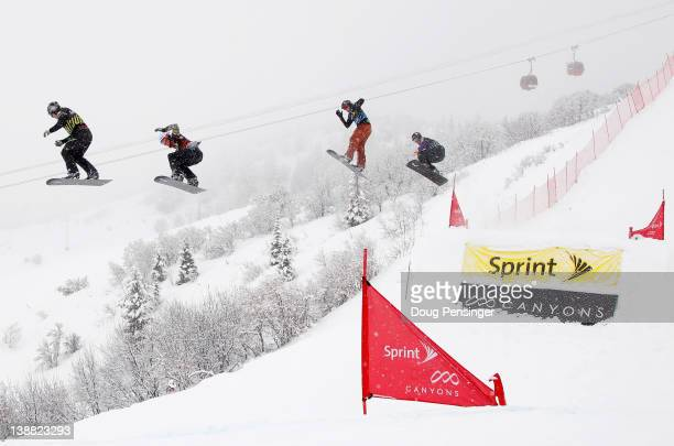 Nate Holland leads Jarryd Hughes in their semifinal heat of the men's Sprint US Grand Prix Snowboardcross Finals at The Canyons Ski Resort on...