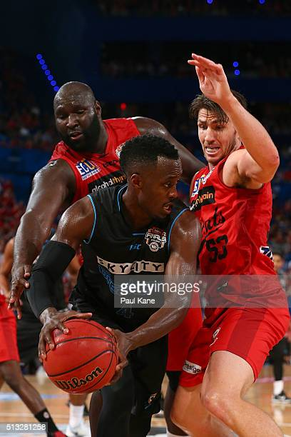Nate Jawai and Damian Martin of the Wildcats attempt to strip the ball from Cedric Jackson of the Breakers during game one of the NBL Grand FInal...