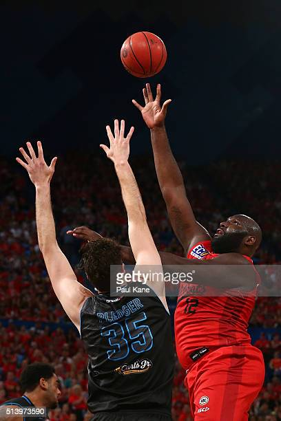 Nate Jawai of the Wildcats puts up a shot against Alex Pledger of the Breakers during game three of the NBL Grand Final series between the Perth...