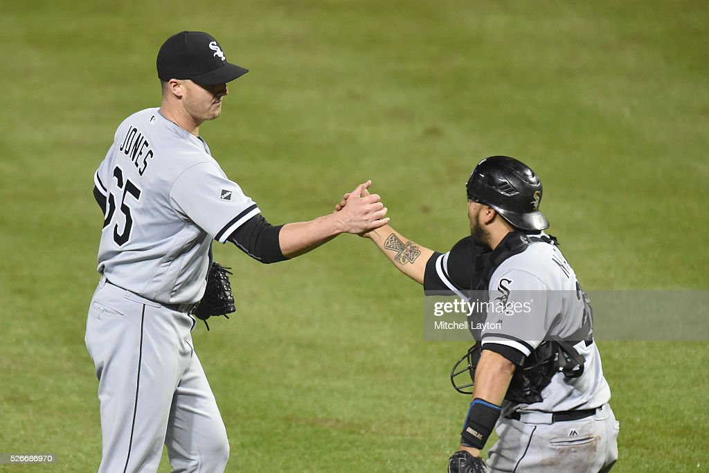 Nate Jones #65 and Dioner Navarro #27 of the Chicago White Sox celebrate a win after a baseball game against the Baltimore Orioles at Oriole Park at Camden yards on April 30, 2016 in Baltimore, Maryland. The White Sox won 8-7.