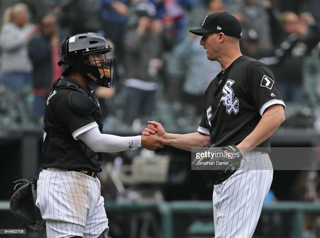Nate Jones #65 of the Chicago White Sox (R) is congratulated by Omar Narvaez #38 after a win against the Tampa Bay Rays at Guaranteed Rate Field on April 11, 2018 in Chicago, Illinois. The White Sox defeated the Rays 2-1.