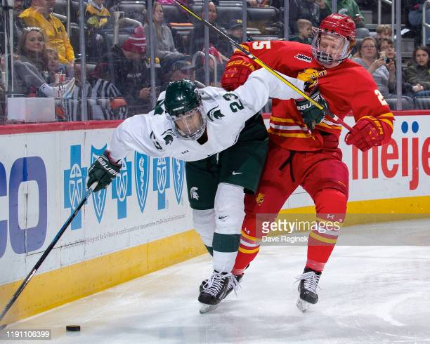 Nate Kallen of the Ferris State Bulldogs battles for the puck with Jake Willets of the Ferris State Bulldogs in the third period of the consolation...
