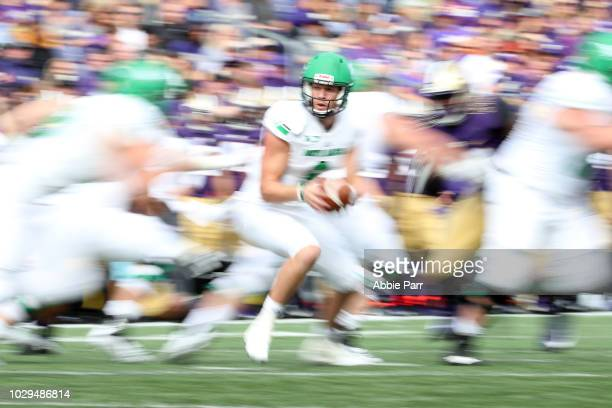 Nate Ketteringham of the North Dakota Fighting Sioux looks to hand the ball off in the third quarter against the Washington Huskies during their game...