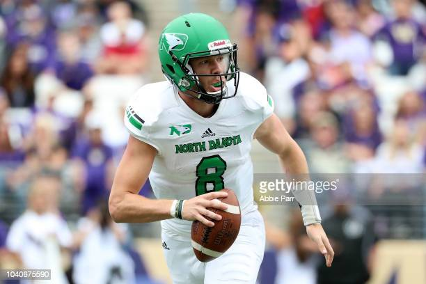 Nate Ketteringham of the North Dakota Fighting Sioux looks to throw the ball in the second quarter against the Washington Huskies during their game...
