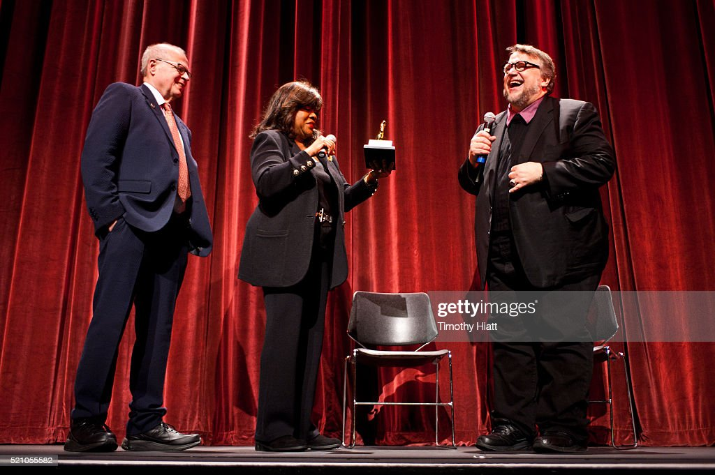 Nate Kohn and Chaz Ebert present Director Guillermo Del Toro with the Golden Thumb on opening night for the 2016 Ebertfest on April 14, 2016 in Champaign, Illinois.