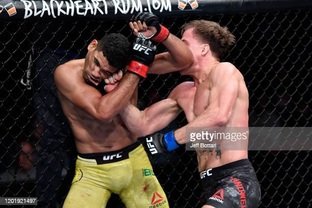 Nate Landwehr punches Herbert Burns of Brazil in their featherweight bout during the UFC Fight Night event at PNC Arena on January 25 2020 in Raleigh...