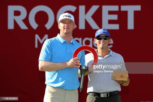 Nate Lashley and caddie Ricky Romano celebrate after winning the Rocket Mortgage Classic at the Detroit Country Club on June 30 2019 in Detroit...