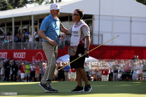 Nate Lashley and caddie Ricky Romano embrace after winning the Rocket Mortgage Classic at the Detroit Country Club on June 30 2019 in Detroit Michigan