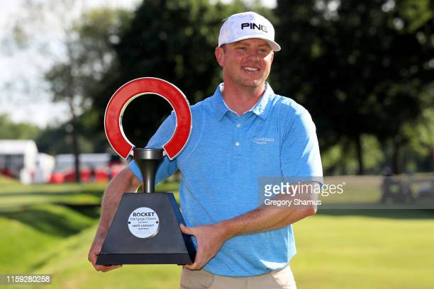 Nate Lashley celebrates with the trophy after winning the Rocket Mortgage Classic at the Detroit Country Club on June 30 2019 in Detroit Michigan