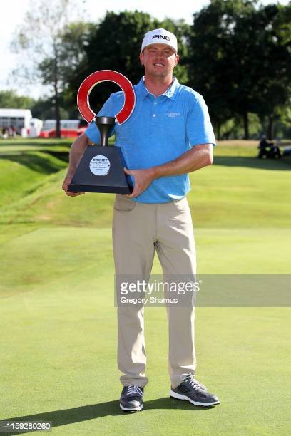 Nate Lashley celebrates with the trophy after winning the Rocket Mortgage Classic at the Detroit Country Club on June 30, 2019 in Detroit, Michigan.