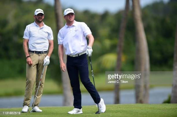 Nate Lashley watches his shot from the third tee as DJ Trahan looks on during the third round of the Puerto Rico Open at Coco Beach Golf and Country...