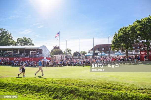 Nate Lashley waves his hat to fans while walking onto the eighteenth green during the final round of the Rocket Mortgage Classic at Detroit Golf Club...