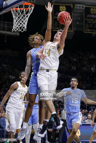 Nate Laszewski of the Notre Dame Fighting Irish shoots the ball against Cole Anthony of the North Carolina Tar Heels during the first half at Purcell...