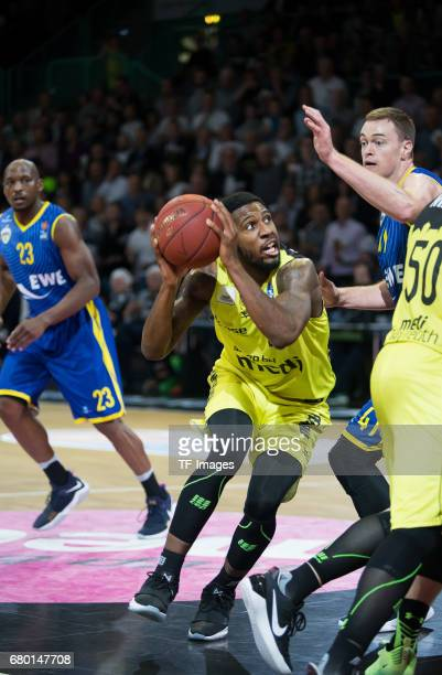 Nate Linhart of medi bayreuth and Brian Qvale battle for the ball during the easyCredit BBL match between medi bayreuth and EWE Baskets Oldenburg at...