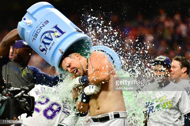 Nate Lowe of the Tampa Bay Rays gets a water cooler bath after a 2-run walk-off against the Boston Red Sox in the eleventh inning of a baseball game...