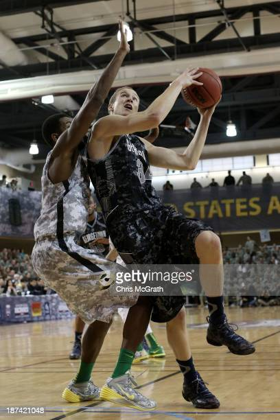 Nate Lubik of the Georgetown Hoyas drives to the basket against the Oregon Ducks during the Armed Forces Classic at United States Army...