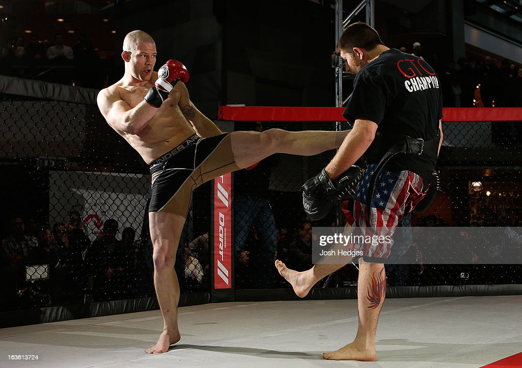 Nate Marquardt (L) conducts an open training session for fans and media ahead of his UFC 158 bout at Complexe Desjardins on March 13, 2013 in Montreal, Quebec, Canada.