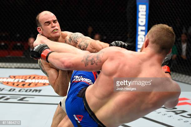 Nate Marquardt kicks Tamdan McCrory in their middleweight bout during the UFC Fight Night event at the Moda Center on October 1 2016 in Portland...