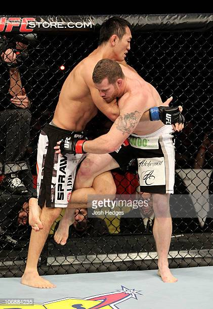 Nate Marquardt of the USA fights with Yushin Okami of Japan during their UFC Middleweight Championship Eliminator bout at the Konig Pilsner Arena on...