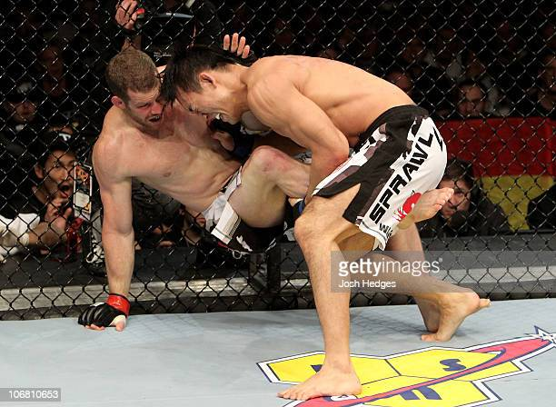 Nate Marquardt of the USA fights Yushin Okami of Japan during their UFC Middleweight Championship Eliminator bout at the Konig Pilsner Arena on...
