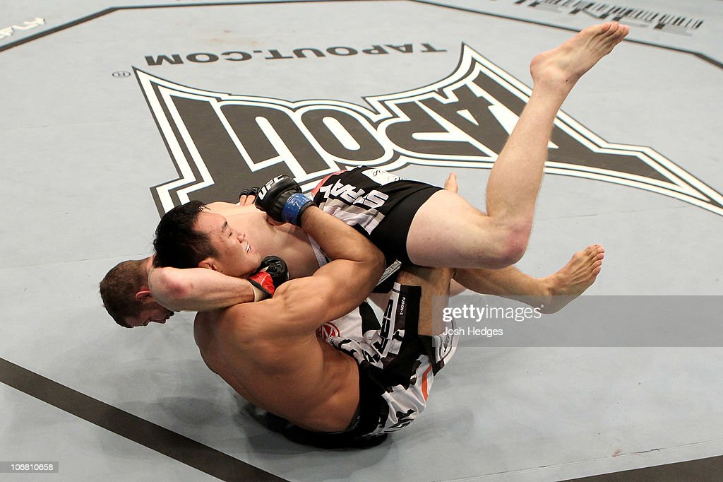 Nate Marquardt of the USA fights Yushin Okami (L) of Japan during their UFC Middleweight Championship Eliminator bout at the Konig Pilsner Arena on November 13, 2010 in Oberhausen, Germany.