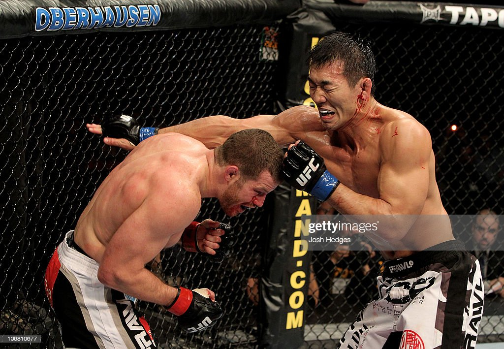 Nate Marquardt of the USA fights Yushin Okami (R) of Japan during their UFC Middleweight Championship Eliminator bout at the Konig Pilsner Arena on November 13, 2010 in Oberhausen, Germany.